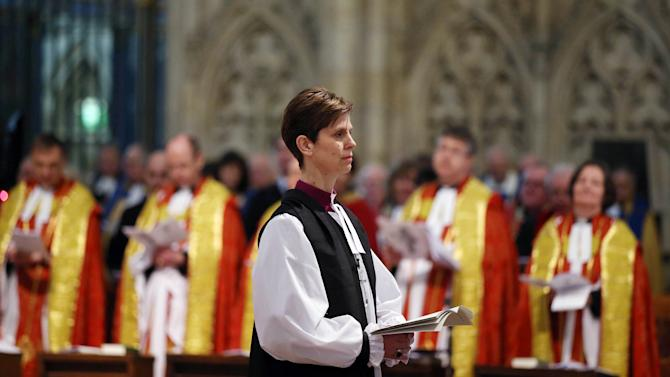 The Reverend Libby Lane reacts during a service where she was consecrated as the first female Bishop in the Church of England at York Minster in York