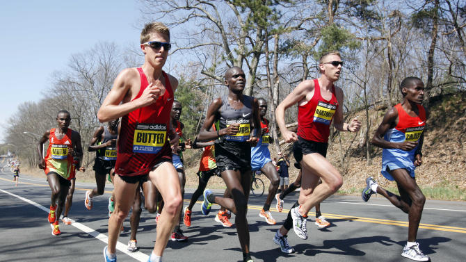 The elite men runners including Geoffrey Mutai, of Kenya, left, Michel Butter, of the Netherlands, second from left, Josphat Ndambiri, of Kenya,  third from right, Jason Hartmann, of Boulder, Col., second from right, and Dickson Chumba, of Kenya, right, compete in the Boston Marathon in Wellesley, Mass., Monday, April 16, 2012. (AP Photo/Michael Dwyer)