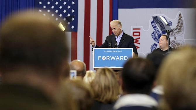 Vice President Joe Biden speaks during a campaign stop at the Bridge View Center, Tuesday, Sept. 18, 2012, in Ottumwa, Iowa, as Ottumwa firefighter Rick Kleinman, right, looks on.   (AP Photo/Charlie Neibergall)