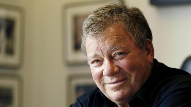 """In this Jan. 30, 2011 photo, Actor William Shatner poses for a portrait in Los Angeles. Captain James T. Kirk will be on hand when the aircraft carrier USS Enterprise is officially retired. A publicist for Shatner says the actor will attend the ship's inactivation ceremony Saturday, Dec. 1, 2012 at Naval Station Norfolk. Shatner is scheduled to perform Friday in Newport News. Shatner played Kirk at the helm of the starship Enterprise in the """"Star Trek"""" television series and several movies. The world's first-nuclear powered aircraft carrier returned to Norfolk from its final deployment earlier this month. Saturday's inactivation will be its last public ceremony. (AP Photo/Matt Sayles)"""