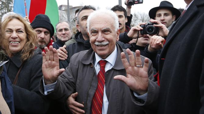 Perincek, Chairman of the Turkish Workers' Party is surrounded by supporters at the end of an hearing at the European court of Human Rights in Strasbourg