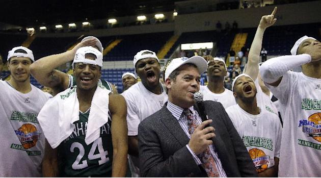 Manhattan head coach Steve Masiello celebrates with his team as he addresses their fans after their NCAA men's MAAC conference championship tournament basketball finals game win over Iona in Sprin