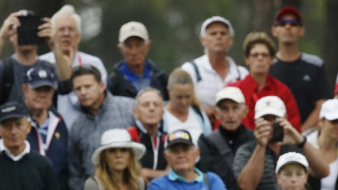 Northern Ireland's McIlroy plays a chip shot onto the 17th green during the first round of the Australian Open golf tournament in Sydney