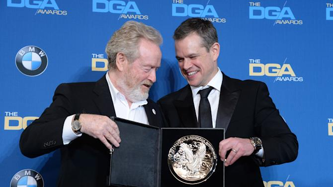 Ridley Scott accepts the Feature Film nomination medallion from Matt Damon during the 68th annual DGA Awards in Los Angeles