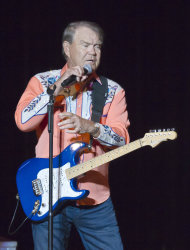 In this photo taken Thursday, Sept. 6, 2012, singer Glen Campbell speaks to fans during his Goodbye Tour in Little Rock, Ark. (AP Photo/Danny Johnston)