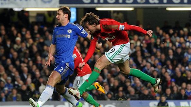 Michu, right, scores Swansea's opening goal of the game against Chelsea