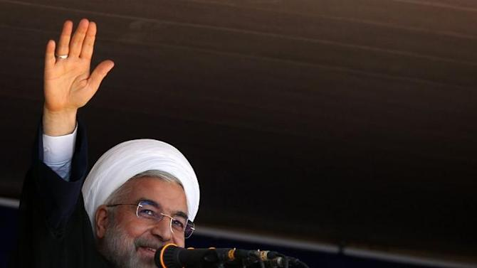 A handout picture released by the official website of the Iranian president show President Hassan Rouhani speaking in Khoramabad, in Iran's western Lorestan region, on June 18, 2014