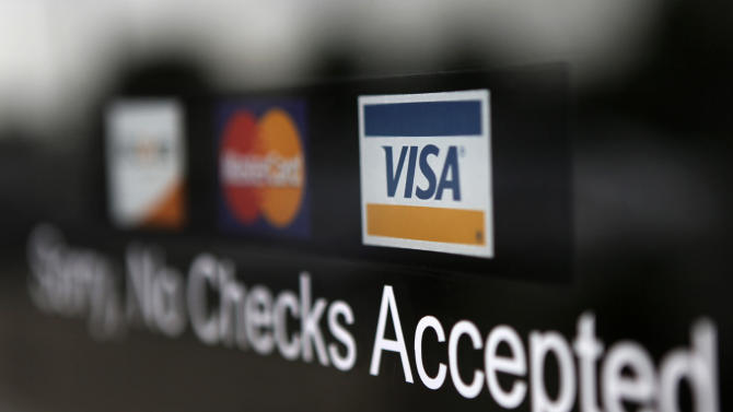FILE - This July 29, 2009 file photo shows a Visa sticker at a business in Detroit. Visa Inc. reports quarterly financial results on Thursday, July 24, 2014. (AP Photo/Paul Sancya)