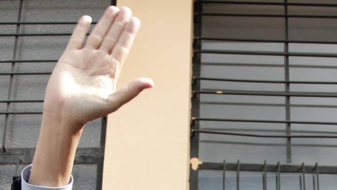 Presidential candidate Guillermo Lasso of the Creating Opportunities Party ( CREO ) waves to supporters at a polling station where he accompanied his running mate Juan Carlos Solines, not seen, to vote in Quito, Ecuador, Sunday, Feb. 17, 2013.  Lasso, a former Banco de Guayaquil executive president,  is the leading opponent to President Rafel Correa who is highly favored to win a second re-election. Ecuadoreans  elect president,  vice-president and National Assembly members Sunday.(AP Photo/Dominique Riofrio)
