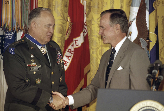 FILE - In this July 4, 1991 file photo, President George Bush congratulates Desert Storm commander Gen. Norman Schwarzkopf after presenting him with the medal of freedom at the White House in Washingt
