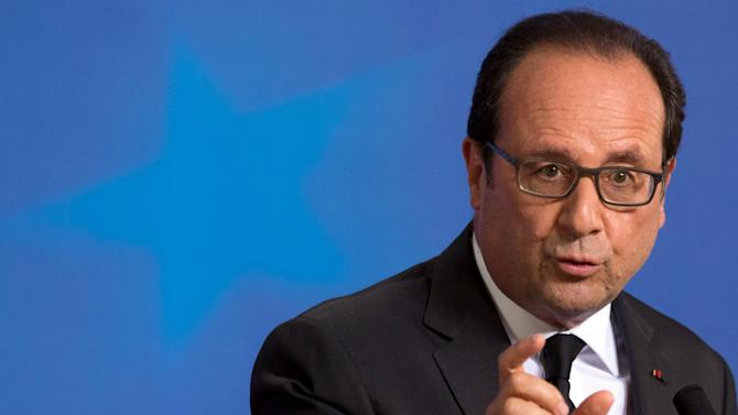 French President Francois Hollande speaks during a news conference following a euro zone leaders summit in Brussels
