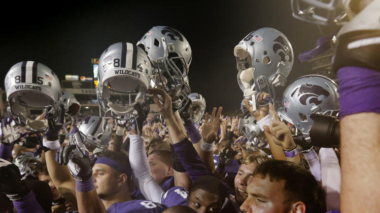 Kansas State players celebrate after their NCAA college football game against Texas Saturday, Dec. 1, 2012, in Manhattan, Kan. Kansas State won the game 42-24. (AP Photo/Charlie Riedel)