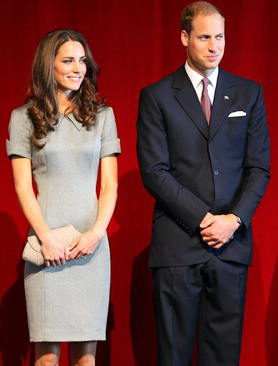 Kate Middleton photos: Grey = boring but not when it's worn Kate style. Turned up short sleeves and a sharp collar add just the right accent to this ultra-formal look.