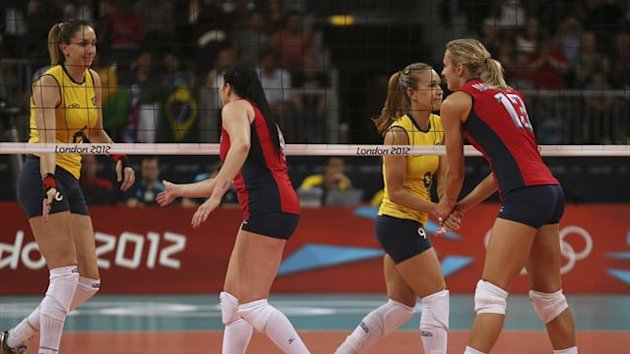 Brazil's Thaisa Menezes (L) and Fernanda Ferreira shake hands with captain Lindsey Berg and Christa Harmotto (R) of the U.S. after their women's Group B volleyball match at London 2012 (Reuters)