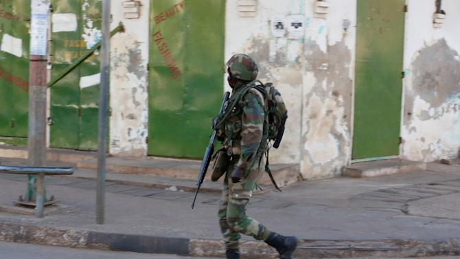 A member of the regional ECOWAS force walks in a street in Banjul