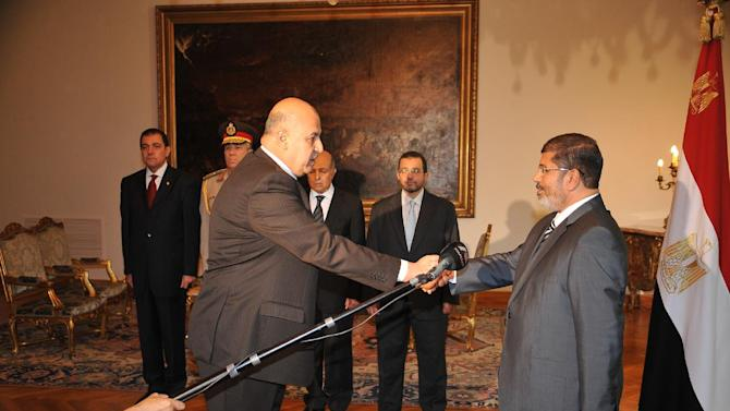 Egyptian President Mohammed Morsi swears in newly-appointed vice president, former senior judge, Mahmoud Mekki, in Cairo, Egypt, Sunday, Aug. 12, 2012. Egypt's Islamist president also ordered his defense minister and chief of staff to retire on Sunday and canceled the military-declared constitutional amendments that gave top generals wide powers. (AP Photo/Egyptian Presidency)