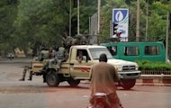 Soldiers drive around a roundabout in central Bamako. Rebel soldiers who took control of Mali in March said they had defeated an attempt to kill coup leader Captain Amadou Haya Sanogo, but insisted that the turmoil would not affect the rule by an interim civilian government