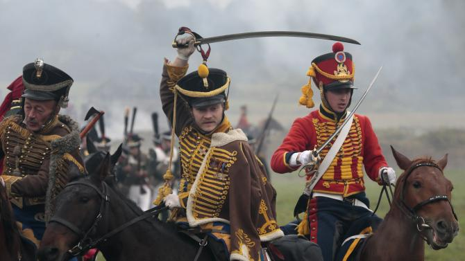Members of historic clubs wearing 1812-era uniforms take part in a staged battle re-enactment to mark the 200th anniversary of the battle of Borodino, in Borodino, about 110 km (70 miles) west of Moscow, Sunday, Sept. 2, 2012. The Battle of Borodino in 1812 was the largest and bloodiest single-day action of the French invasion of Russia. (AP Photo/Mikhail Metzel)