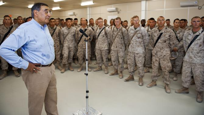 US Secretary of Defense Leon Panetta delivers remarks thanking front line troops from the USN/USMC Combat Logistics Battalion 7 and USMC Route Clearance Team while making an unannounced visit to Camp Dwyer, Sunday July 10, 2011, in  southern Afghanistan. Panetta visited troops in southern Afghanistan  as part of his first trip to the country since taking up his post and ahead of a withdrawal of some US forces. (AP Photo/Paul J. Richards Pool)