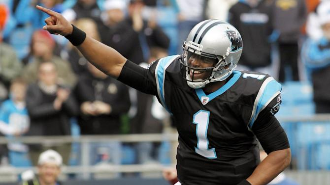 FILE - In this Dec. 24, 2011, file photo, Carolina Panthers quarterback Cam Newton (1) reacts after a touchdown against the Tampa Bay Buccaneers during the third quarter of an NFL football game in Charlotte, N.C. Newton was selected as The Associated Press' NFL Offensive Rookie of the Year Award on Saturday, Feb. 4, 2012. (AP Photo/Bob Leverone, File)