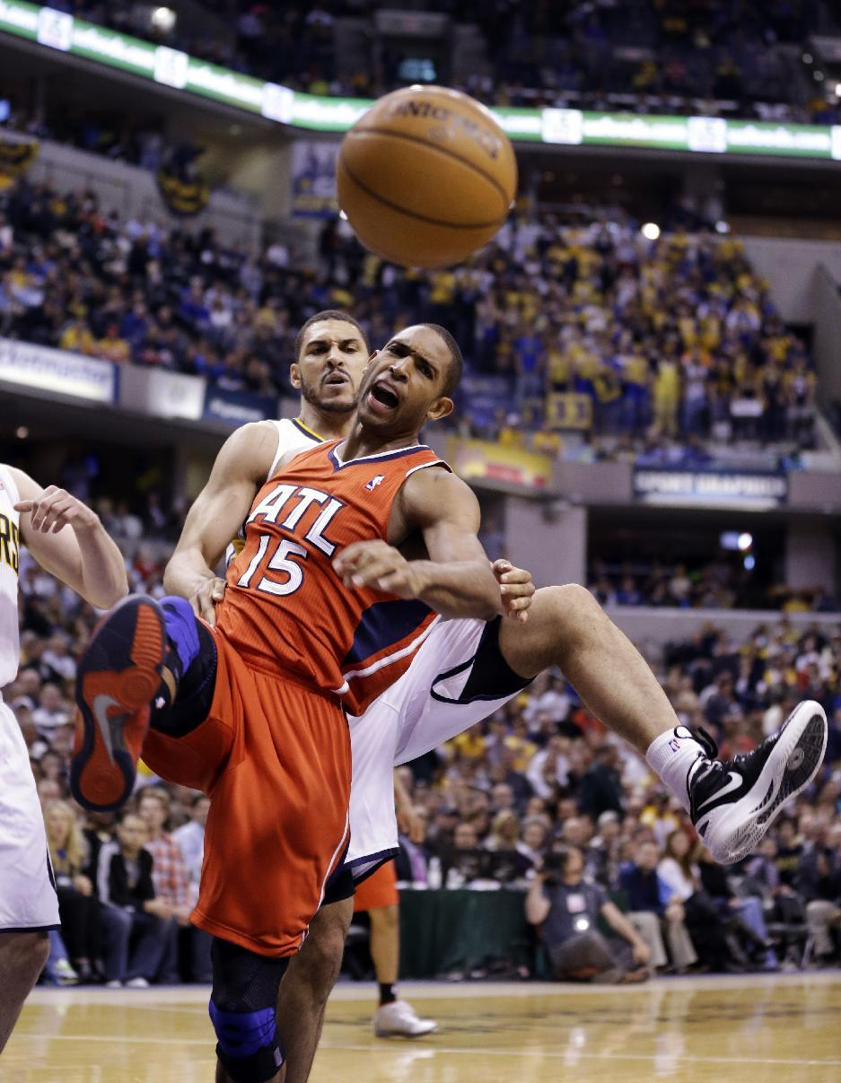 Atlanta Hawks center Al Horford (15) is fouled from behind by Indiana Pacers forward Jeff Pendergraph in the first half of Game 2 of a first-round NBA basketball playoff series in Indianapolis, Wednesday, April 24, 2013. (AP Photo/Michael Conroy)