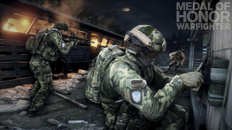 """This product image released by Electronic Arts shows action from the video game """"Medal of Honor: Warfighter."""" Seven members of the secretive Navy SEAL Team 6, including one involved in the mission to kill Osama bin Laden, have been punished for allegedly divulging classified information to the maker of the game, senior Navy officials said Thursday, Nov. 8, 2012. (AP Photo/Electronic Arts)"""