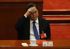 Yu Zhengsheng, Chairman of the CPPCC National Comittee gestures during the closing ceremony of the Chinese National People's Congress at the Great Hall of the People, in Beijing