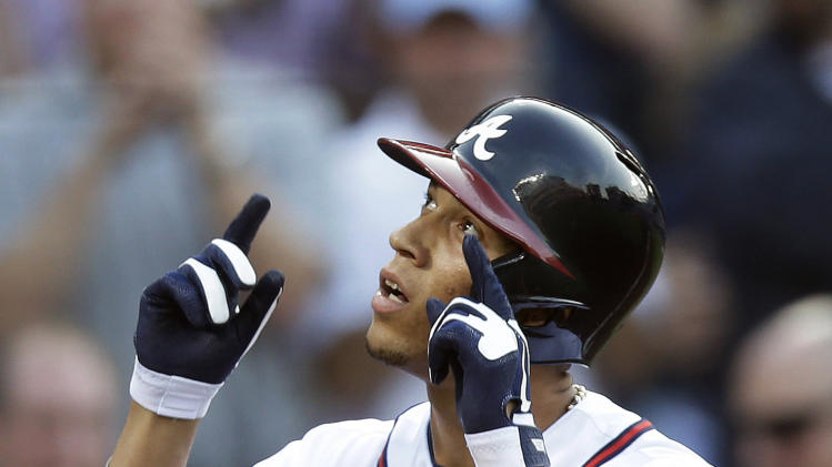 Atlanta Braves' Andrelton Simmons gestures after hitting a solo home run in the first inning of a baseball game against the Washington Nationals on Tuesday, April 30, 2013, in Atlanta. (AP Photo/John Bazemore)