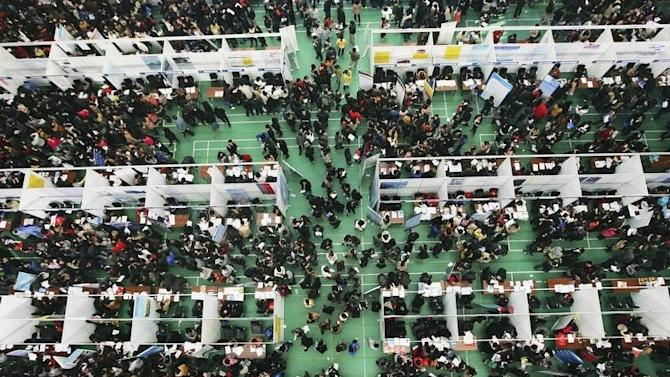 Job seekers attend a job fair at Tianjin University