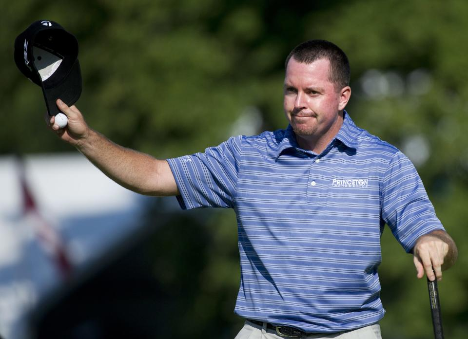 Robert Garrigus reacts to the crowd after finishing 18 during the Canadian Open golf tournament at the Hamilton Golf and County Club in Ancaster, Ontario, Saturday, July 28, 2012. (AP Photo/The Canadian Press, Nathan Denette)