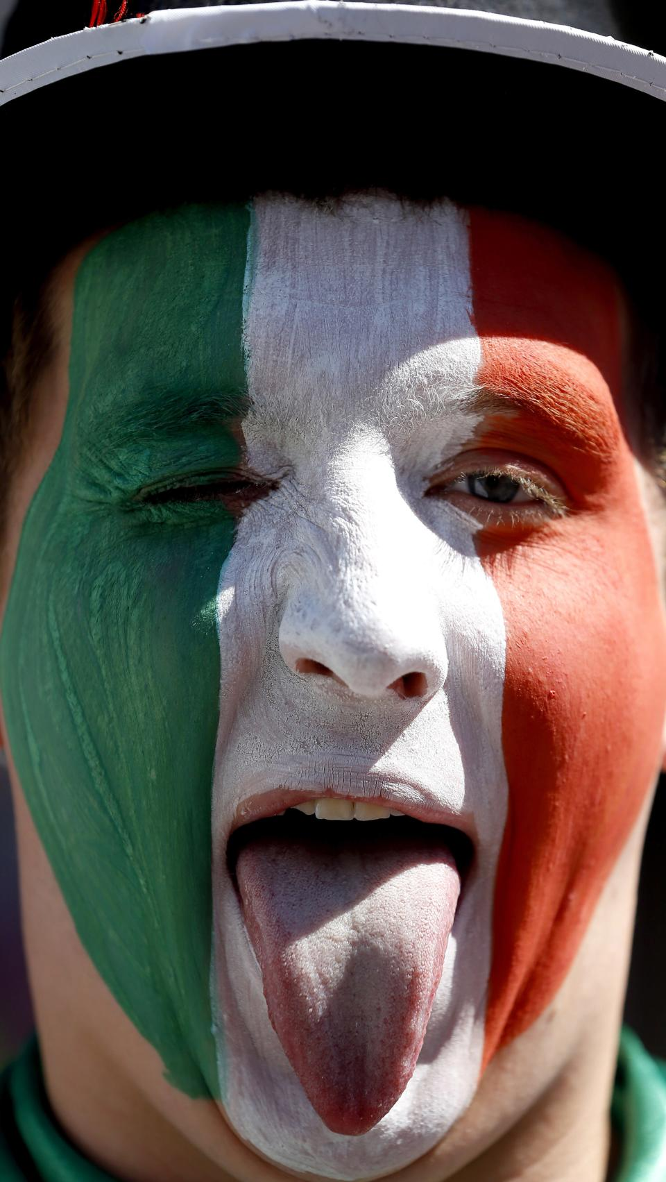 An Italy fan shows his tongue in the fan zone in Kiev, Ukraine, Sunday, June 24, 2012. Italy will play England in a Euro 2012 quarterfinal soccer match later Sunday. (AP Photo/Kirsty Wigglesworth)