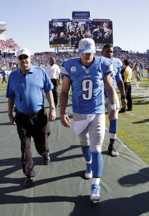 Detroit Lions quarterback Matthew Stafford (9) leaves the field after losing to the Tennessee Titans 44-41 in overtime at an NFL football game on Sunday, Sept. 23, 2012, in Nashville, Tenn. (AP Photo/Wade Payne)