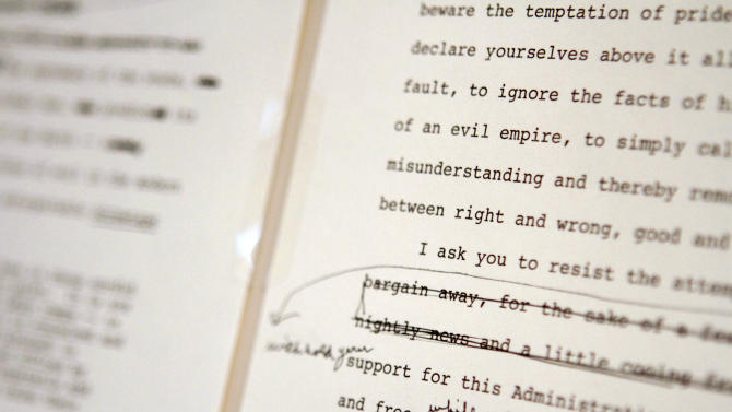 """Pages of President Ronald Reagan's """"Evil Empire"""" speech, with his hand-written edits, are seen at the National Archives, in Washington, Wednesday, Jan. 5, 2011, during a press preview of rarely displayed original documents and artifacts in recognition of the Ronald Reagan Centennial. (AP Photo/Jacquelyn Martin)"""