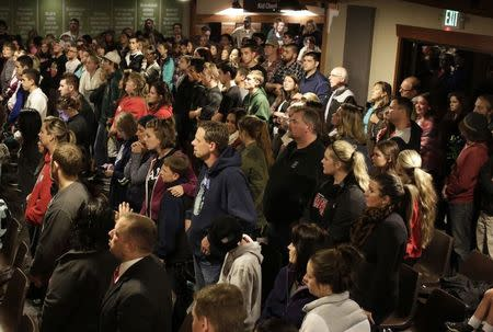 People attend a community vigil at the Grove Church following a shooting at Marysville-Pilchuck High School in Marysville