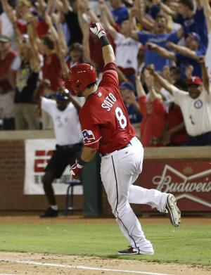 Texas Rangers' Geovany Soto rounds the bases after hitting a walk-off home run against the Los Angeles Angels during the ninth inning of a baseball game, Monday, July 29, 2013, in Arlington, Texas. The Rangers won 4-3. (AP Photo/Jim Cowsert)