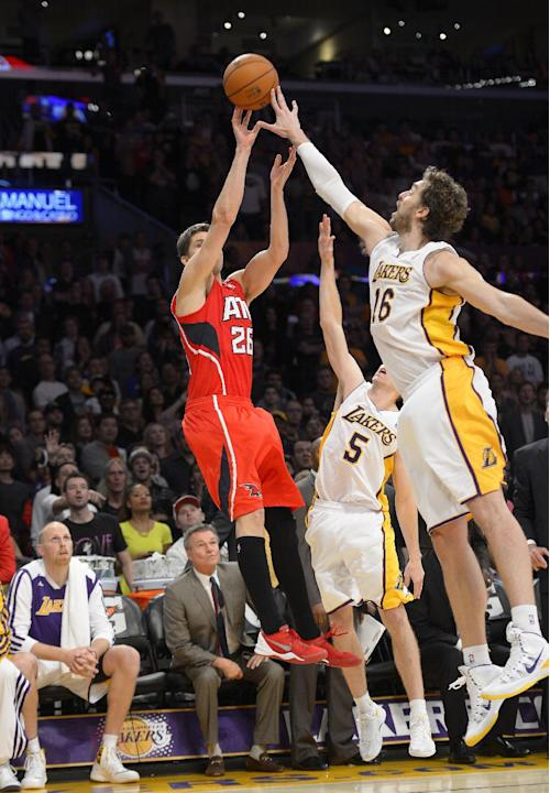Los Angeles Lakers forward Pau Gasol, right, of Spain, blocks a shot by Atlanta Hawks forward Kyle Korver in the last few second of their NBA basketball game, Sunday, Nov. 3, 2013, in Los Angeles. The