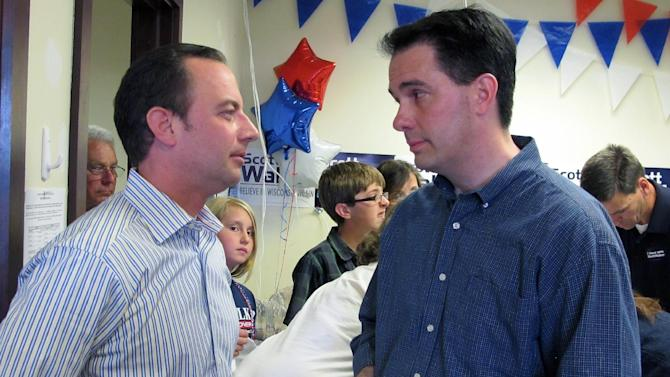 Wisconsin Gov. Scott Walker, right, talks with Republican National Committee Chairman Reince Priebus at a Republican campaign office in Germantown, Wis., on Sunday, June 3, 2012. Walker and Priebus were rallying volunteers ahead of a recall election for Walker on Tuesday. (AP Photo/Dinesh Ramde)
