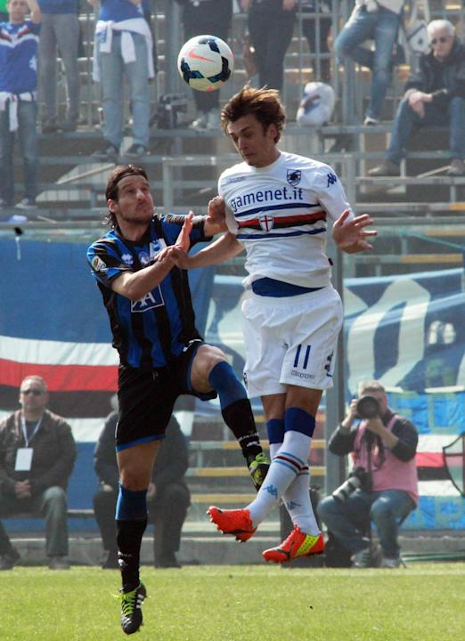 Sampdoria's forward Manolo Gabbiadini, right, and Atalanta's Cristiano Del Grosso jump for the header during a Serie A soccer match in Bergamo, Italy, Sunday, March 16, 2014