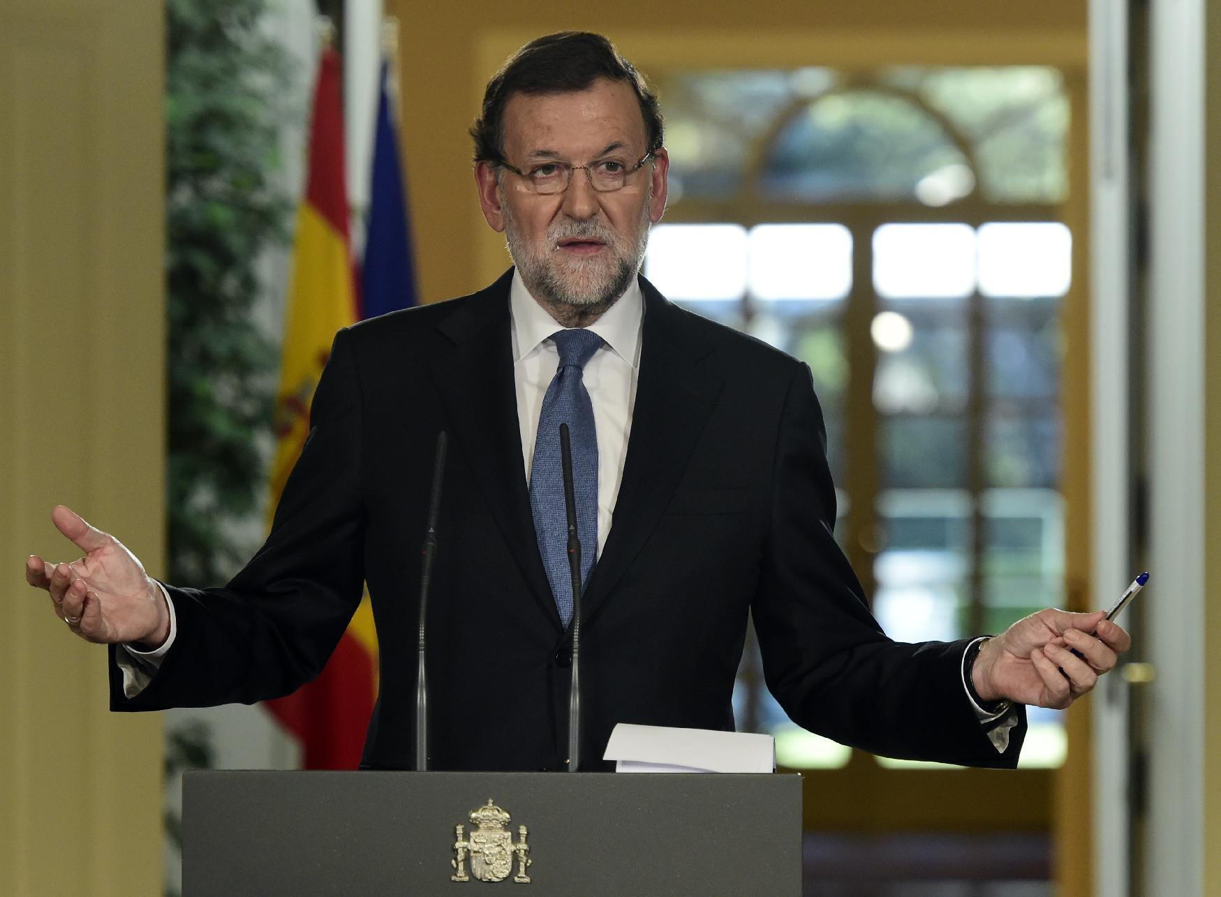 Spain PM promises economy will 'take off' in 2015