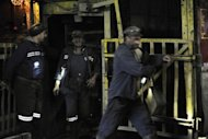 Miners return to the surface after a six hour night shift in a mine in Petrila, central Romania. The recovery in Romania's economy after two years of severe recession is now coming under threat, analysts warn, victim to the months-long political crisis that has engulfed the EU country