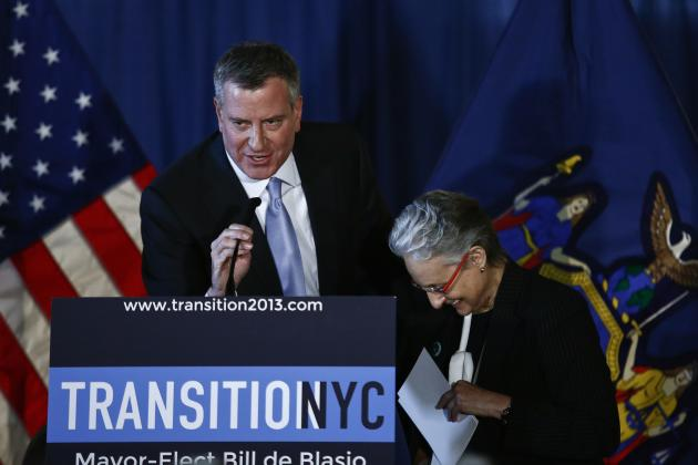 New York Mayor-elect De Blasio introduces Barrios-Paoli at a news conference in New York