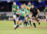 New Zealand&#39;s Otago Highlanders player Tamati Ellison (C) makes a run during their rugby union Super 15 series match against South Africa&#39;s Coastal Sharks at the Kings Park Rugby Stadium in Durban, in May. The Highlanders play Waikato Chiefs next, on Friday, as the series resumes this weekend after the international season break