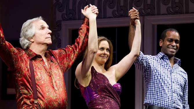 """Henry Winkler, left, Alicia Silverstone, center, and Daniel Breaker appear on stage at the curtain call for the opening night performance of the Broadway play, """"The Performers,"""" on Wednesday, Nov. 14, 2012, in New York. (Photo by Charles Sykes/Invision/AP)"""