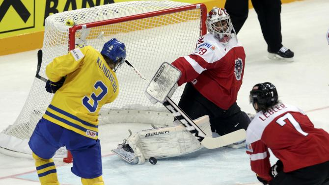 Sweden's Klingberg attempts to score past Austria's goaltender Strakbaum and Lebler during their Ice Hockey World Championship game at the O2 arena in Prague