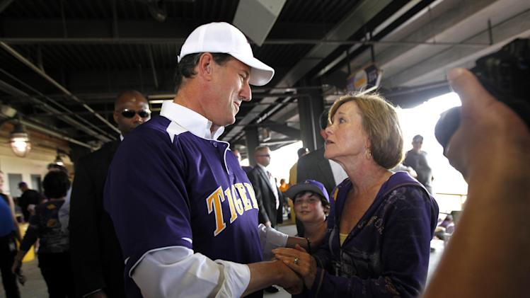 Republican presidential candidate, former Pennsylvania Sen. Rick Santorum, greets LSU fans at the LSU vs. Mississippi State NCAA college baseball game at Alex Box Stadium in Baton Rouge, La., Sunday, March 18, 2012. (AP Photo/Gerald Herbert)