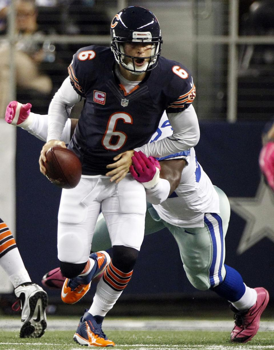 Dallas Cowboys outside linebacker DeMarcus Ware (94) sacks Chicago Bears quarterback Jay Cutler (6) during the first half of an NFL football game, Monday, Oct. 1, 2012, in Arlington, Texas. (AP Photo/LM Otero)