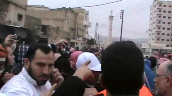 This image from amateur video made available by the Ugarit News group on Monday, Jan. 2, 2012, purports to show observers talking with protesters in Hama, Syria.(AP Photo/Ugarit News Group via APTN) THE ASSOCIATED PRESS CANNOT INDEPENDENTLY VERIFY THE CONTENT, DATE, LOCATION OR AUTHENTICITY OF THIS MATERIAL.  TV OUT