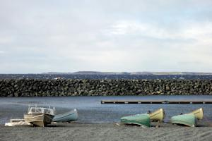 Canoes and boats lying at the waters edge in the Inuit …