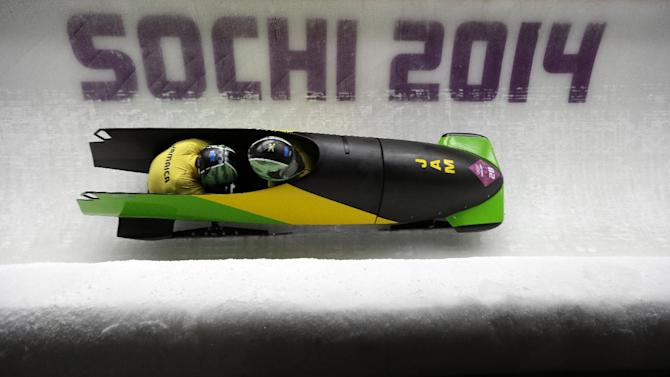 The team from Jamaica JAM-1, piloted by Winston Watts and brakeman Marvin Dixon, take a curve during the men's two-man bobsled competition at the 2014 Winter Olympics, Sunday, Feb. 16, 2014, in Krasnaya Polyana, Russia