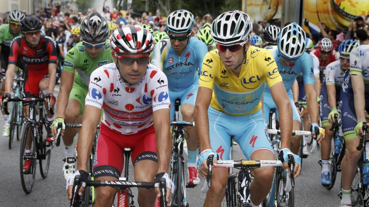 Race leader and yellow jersey holder Nibali speaks with best climber Rodriguez during the 237.5km16th stage of the Tour de France cycling race